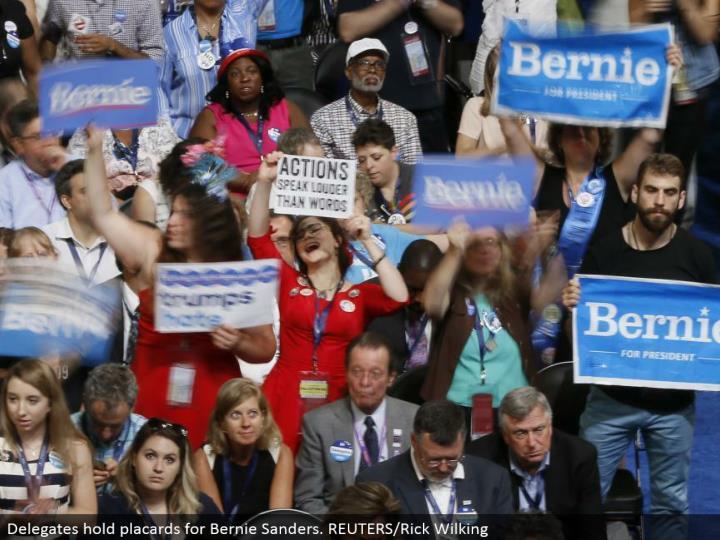 Delegates hold bulletins for Bernie Sanders. REUTERS/Rick Wilking