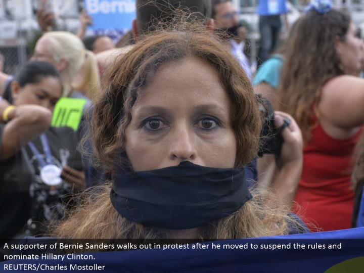A supporter of Bernie Sanders exits in dissent after he moved to suspend the tenets and select Hillary Clinton.  REUTERS/Charles Mostoller
