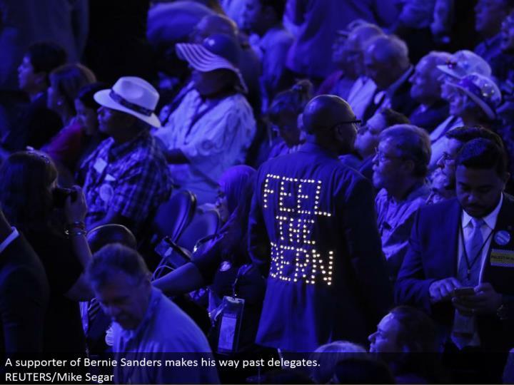 A supporter of Bernie Sanders advances past agents.  REUTERS/Mike Segar