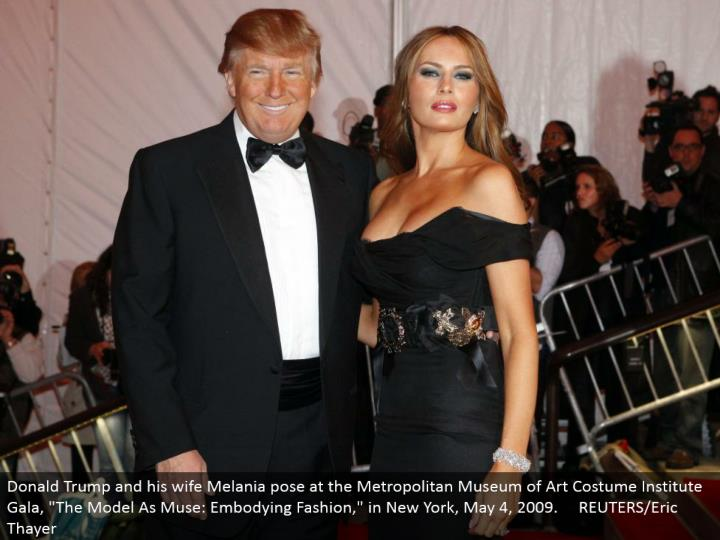 "Donald Trump and his better half Melania posture at the Metropolitan Museum of Art Costume Institute Gala, ""The Model As Muse: Embodying Fashion,"" in New York, May 4, 2009. REUTERS/Eric Thayer"