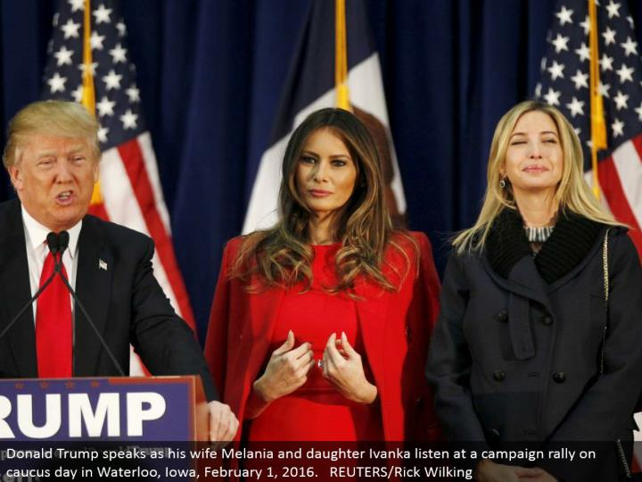 Donald Trump talks as his better half Melania and little girl Ivanka listen at a battle rally on council day in Waterloo, Iowa, February 1, 2016. REUTERS/Rick Wilking