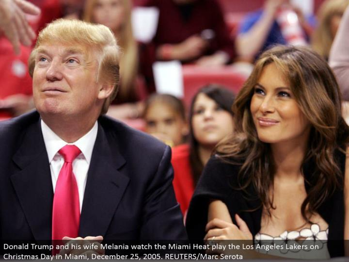 Donald Trump and his significant other Melania watch the Miami Heat play the Los Angeles Lakers on Christmas Day in Miami, December 25, 2005. REUTERS/Marc Serota
