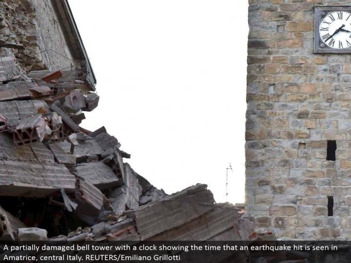 A generally hurt ringer tower with a clock showing the time that a seismic tremor hit is found in Amatrice, central Italy. REUTERS/Emiliano Grillotti