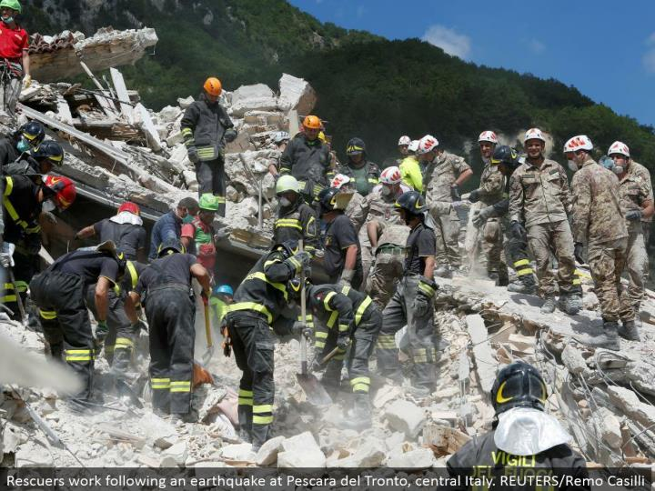 Rescuers work taking after a tremor at Pescara del Tronto, central Italy. REUTERS/Remo Casilli