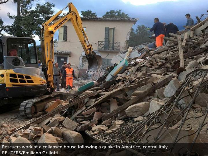 Rescuers work at a given way house taking after a shiver in Amatrice, central Italy. REUTERS/Emiliano Grillotti