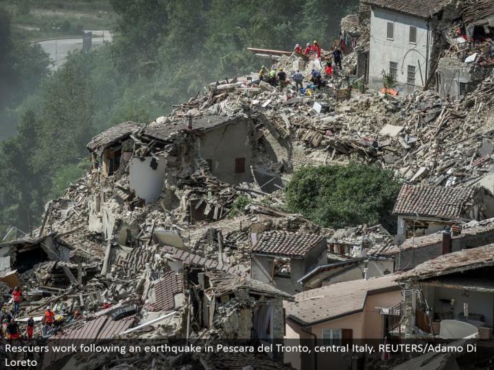Rescuers work taking after a seismic tremor in Pescara del Tronto, central Italy. REUTERS/Adamo Di Loreto