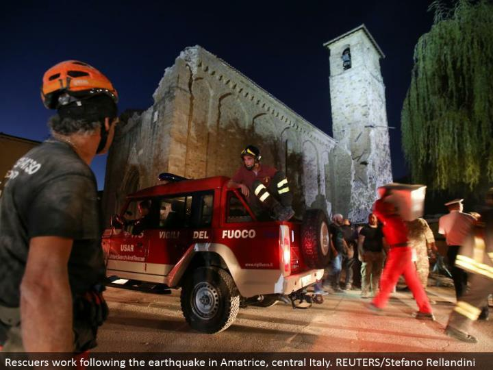 Rescuers work taking after the seismic tremor in Amatrice, central Italy. REUTERS/Stefano Rellandini