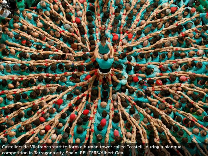 """Castellers de Vilafranca begin to frame a human tower called """"castell"""" amid a half-yearly rivalry in..."""