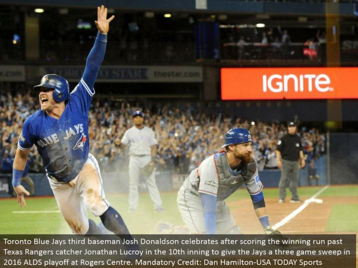 Toronto Blue Jays third baseman Josh Donaldson celebrates subsequent to scoring the triumphant keep running past Texas Rangers catcher Jonathan Lucroy in the tenth inning to give the Jays a three amusement clear in 2016 ALDS playoff at Rogers Center. Required Credit: Dan Hamilton-USA TODAY Sports