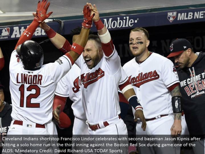 Cleveland Indians shortstop Francisco Lindor celebrates with second baseman Jason Kipnis subsequent ...