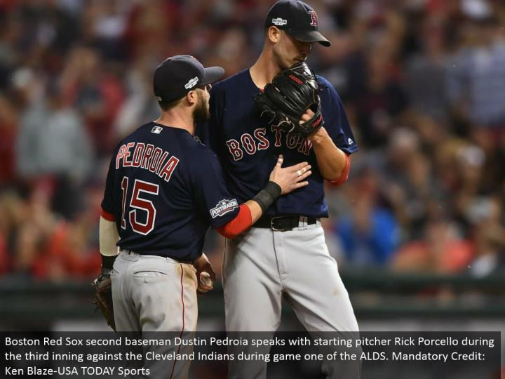 Boston Red Sox second baseman Dustin Pedroia talks with beginning pitcher Rick Porcello amid the third inning against the Cleveland Indians amid diversion one of the ALDS. Obligatory Credit: Ken Blaze-USA TODAY Sports