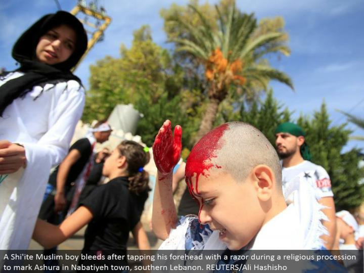 A Shi'ite Muslim kid seeps in the wake of tapping his temple with a razor amid a religious parade to stamp Ashura in Nabatiyeh town, southern Lebanon. REUTERS/Ali Hashisho