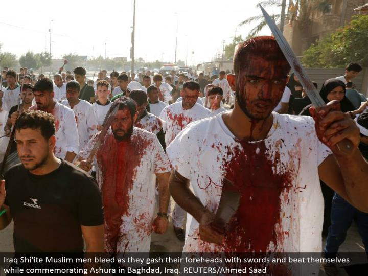 Iraq Shi'ite Muslim men seep as they slash their brows with swords and beat themselves while honoring Ashura in Baghdad, Iraq. REUTERS/Ahmed Saad