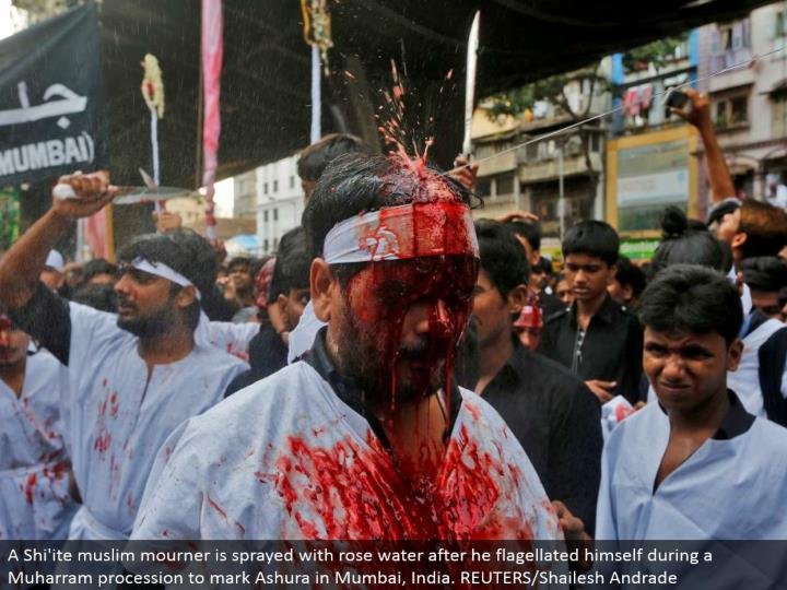 A Shi'ite muslim griever is showered with rose water after he whipped himself amid a Muharram parade to check Ashura in Mumbai, India. REUTERS/Shailesh Andrade