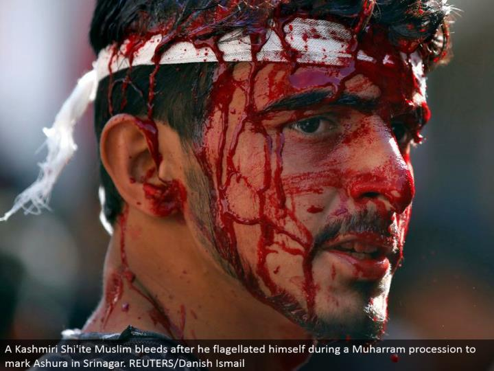 A Kashmiri Shi'ite Muslim seeps after he whipped himself amid a Muharram parade to stamp Ashura in Srinagar. REUTERS/Danish Ismail