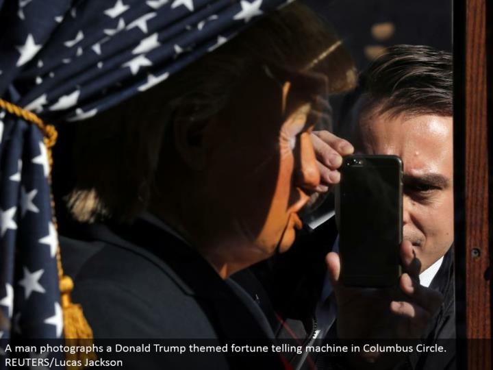 A man photos a Donald Trump themed fortune telling machine in Columbus Circle. REUTERS/Lucas Jackson