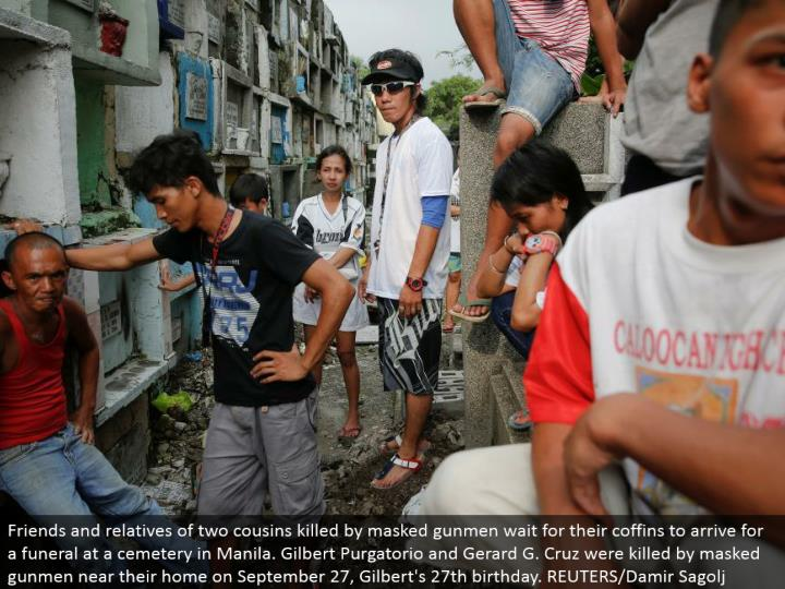 Friends and relatives of two cousins murdered by covered shooters sit tight for their pine boxes to touch base for a memorial service at a burial ground in Manila. Gilbert Purgatorio and Gerard G. Cruz were killed by conceal shooters close to their home on September 27, Gilbert's 27th birthday. REUTERS/Damir Sagolj