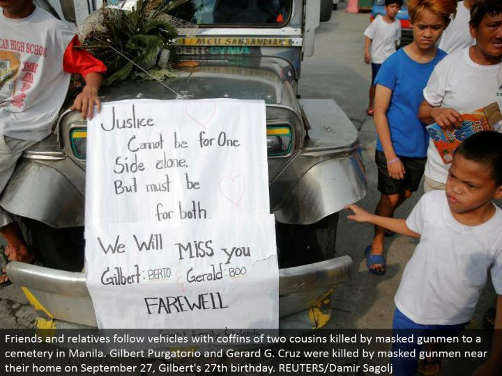 Friends and relatives take after vehicles with caskets of two cousins murdered by conceal shooters to a burial ground in Manila. Gilbert Purgatorio and Gerard G. Cruz were killed by veiled shooters close to their home on September 27, Gilbert's 27th birthday. REUTERS/Damir Sagolj