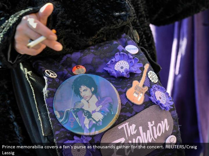Prince memorabilia covers a fan's handbag as thousands accumulate for the show. REUTERS/Craig Lassig