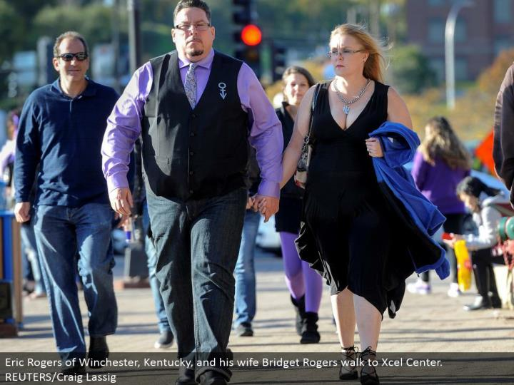 Eric Rogers of Winchester, Kentucky, and his significant other Bridget Rogers stroll to Xcel Center. REUTERS/Craig Lassig