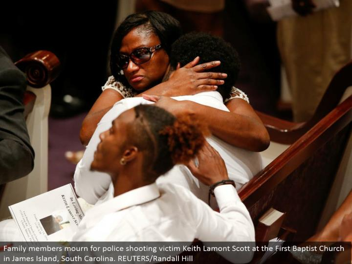 Family individuals grieve for police shooting casualty Keith Lamont Scott at the First Baptist Church in James Island, South Carolina. REUTERS/Randall Hill