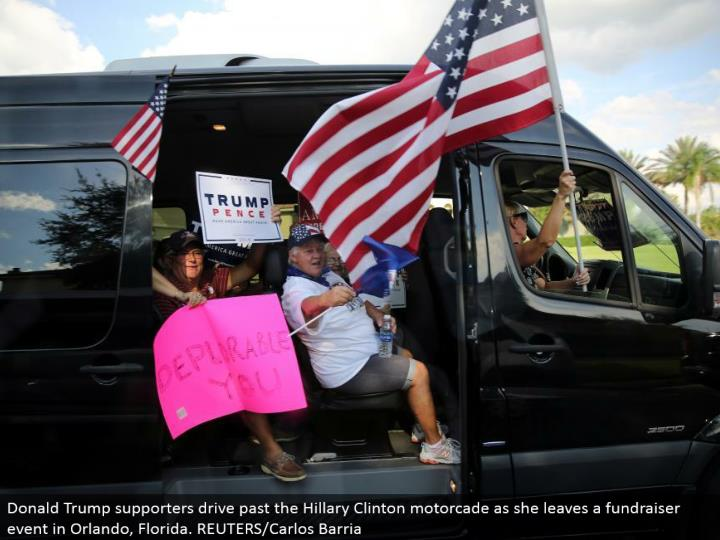 Donald Trump supporters drive past the Hillary Clinton motorcade as she leaves a pledge drive occasion in Orlando, Florida. REUTERS/Carlos Barria