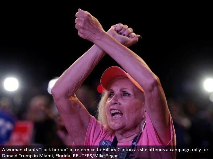 "A lady serenades ""Bolt her up"" in reference to Hillary Clinton as she goes to a crusade rally for Donald Trump in Miami, Florida. REUTERS/Mike Segar"