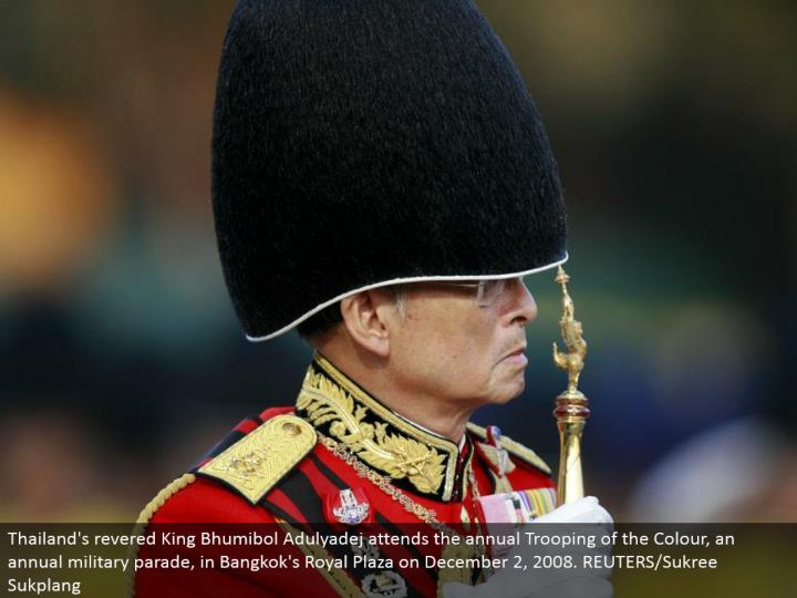 Thailand's venerated King Bhumibol Adulyadej goes to the yearly Trooping of the Color, a yearly military parade, in Bangkok's Royal Plaza on December 2, 2008. REUTERS/Sukree Sukplang