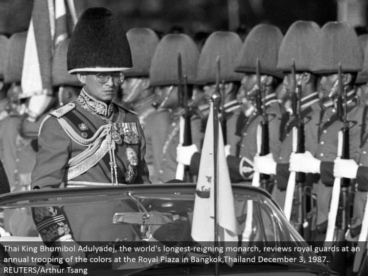 Thai King Bhumibol Adulyadej, the world's longest-authoritative ruler, surveys illustrious gatekeepe...
