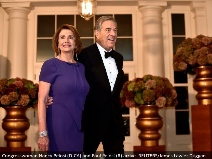 Congresswoman Nancy Pelosi (D-CA) and Paul Pelosi (R) arrive. REUTERS/James Lawler Duggan