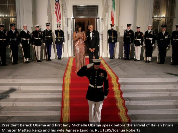 President Barack Obama and first woman Michelle Obama talk before the entry of Italian Prime Minister Matteo Renzi and his significant other Agnese Landini. REUTERS/Joshua Roberts