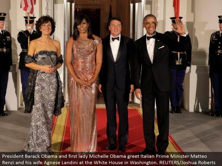 President Barack Obama and first woman Michelle Obama welcome Italian Prime Minister Matteo Renzi and his significant other Agnese Landini at the White House in Washington. REUTERS/Joshua Roberts
