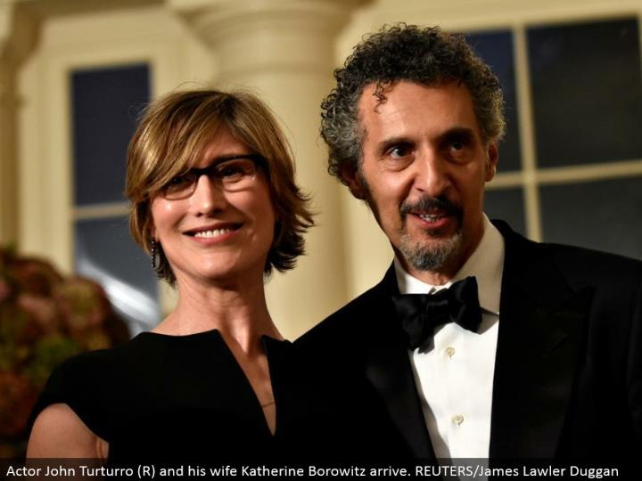 Actor John Turturro (R) and his significant other Katherine Borowitz arrive. REUTERS/James Lawler Duggan
