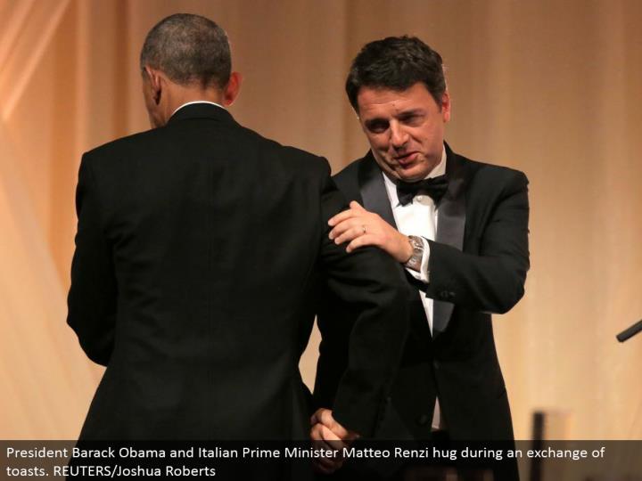 President Barack Obama and Italian Prime Minister Matteo Renzi embrace amid a trade of toasts. REUTERS/Joshua Roberts