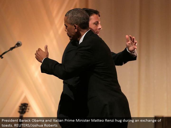 President Barack Obama and Italian Prime Minister Matteo Renzi embrace amid a trade of toasts. REUTE...