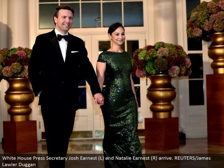 White House Press Secretary Josh Earnest (L) and Natalie Earnest (R) arrive. REUTERS/James Lawler Duggan