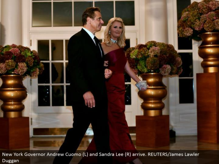 New York Governor Andrew Cuomo (L) and Sandra Lee (R) arrive. REUTERS/James Lawler Duggan