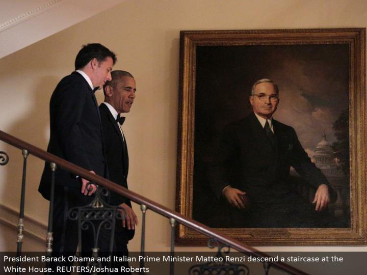 President Barack Obama and Italian Prime Minister Matteo Renzi plummet a staircase at the White House. REUTERS/Joshua Roberts