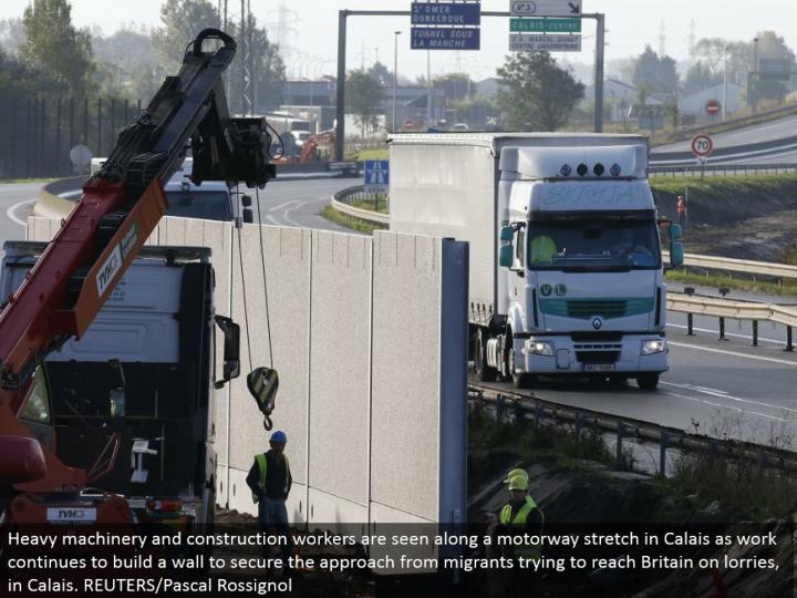 Heavy hardware and development laborers are seen along a motorway extend in Calais as work keeps on building a divider to secure the approach from vagrants attempting to achieve Britain on lorries, in Calais. REUTERS/Pascal Rossignol