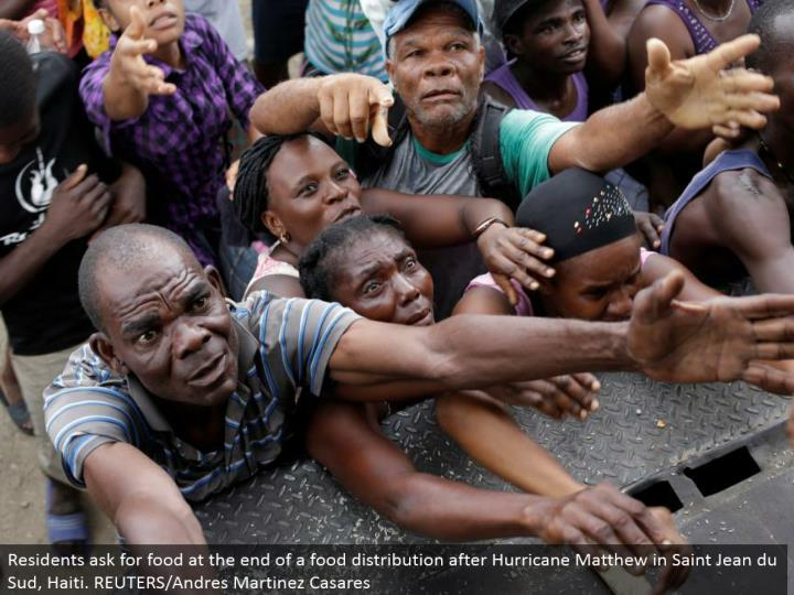 Residents request sustenance toward the end of a nourishment appropriation after Hurricane Matthew in Saint Jean du Sud, Haiti. REUTERS/Andres Martinez Casares