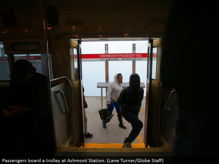 Passengers board a trolley at Ashmont Station. (Path Turner/Globe Staff)