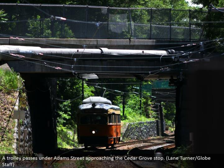 A trolley goes under Adams Street drawing closer the Cedar Grove stop. (Path Turner/Globe Staff)