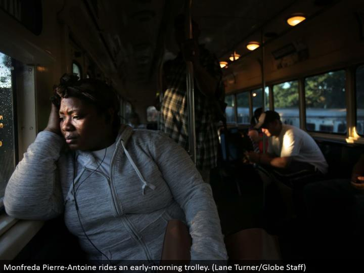 Monfreda Pierre-Antoine rides an early-morning trolley. (Path Turner/Globe Staff)