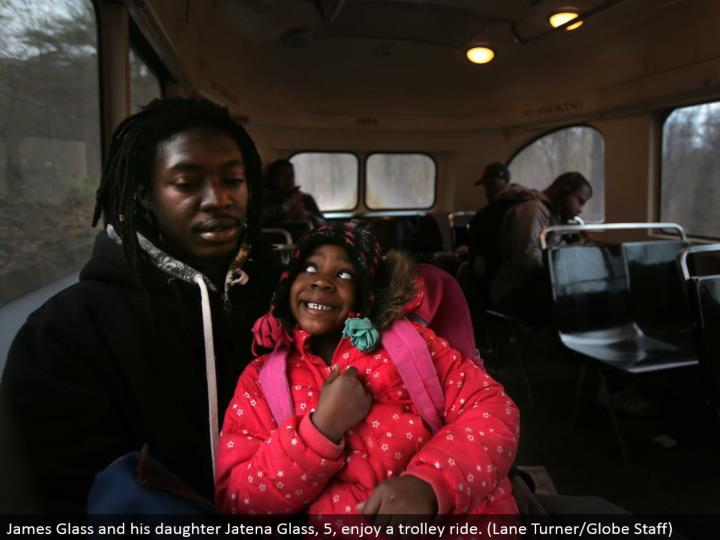 James Glass and his little girl Jatena Glass, 5, appreciate a trolley ride. (Path Turner/Globe Staff)