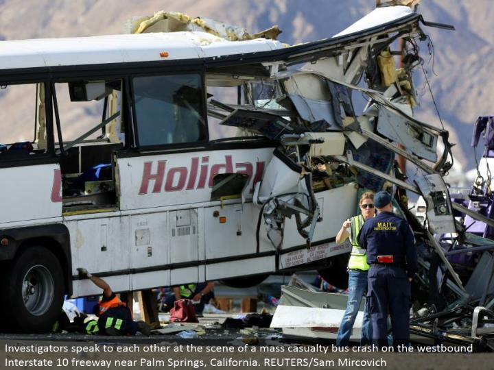 Investigators address each other at the scene of a mass setback transport crash on the westward Interstate 10 turnpike close Palm Springs, California. REUTERS/Sam Mircovich