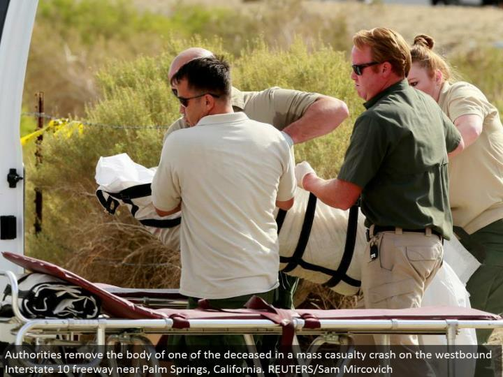 Authorities expel the group of one of the perished in a mass loss crash on the westward Interstate 10 expressway close Palm Springs, California. REUTERS/Sam Mircovich