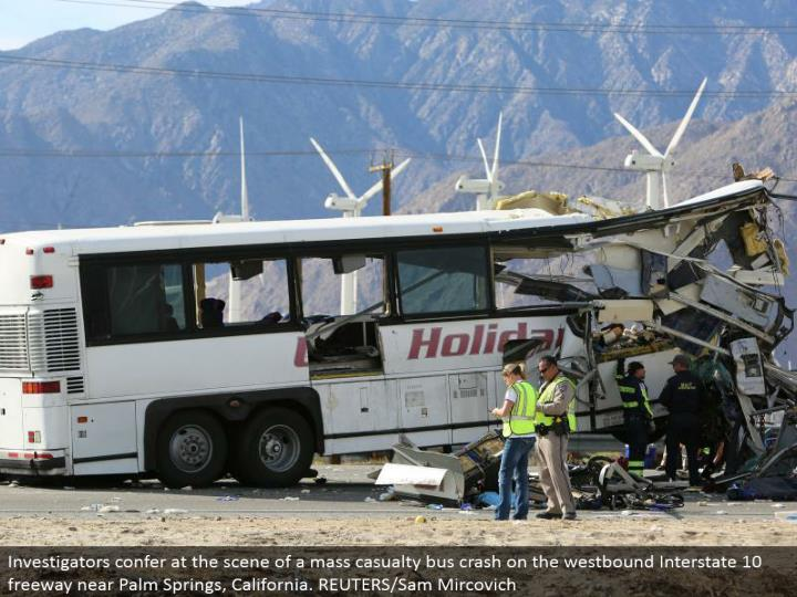 Investigators give at the scene of a mass setback transport crash on the westward Interstate 10 road close Palm Springs, California. REUTERS/Sam Mircovich