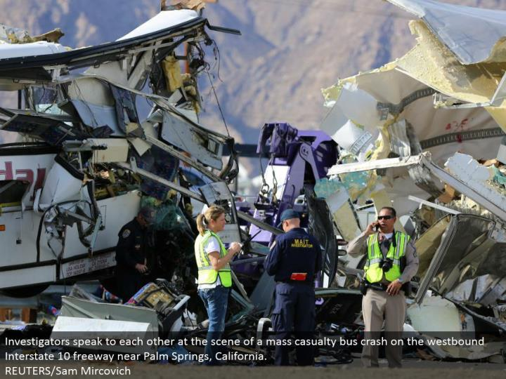 Investigators address each other at the scene of a mass loss transport crash on the westward Interstate 10 road close Palm Springs, California.  REUTERS/Sam Mircovich