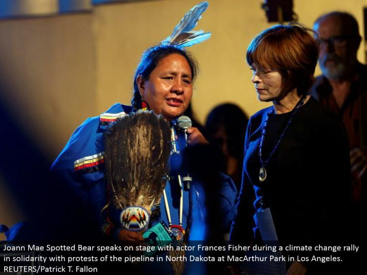 Joann Mae Spotted Bear talks in front of an audience with performing artist Frances Fisher amid an environmental change rally in solidarity with challenges of the pipeline in North Dakota at MacArthur Park in Los Angeles. REUTERS/Patrick T. Fallon