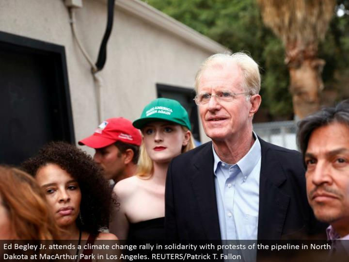 Ed Begley Jr. goes to an environmental change rally in solidarity with challenges of the pipeline in North Dakota at MacArthur Park in Los Angeles. REUTERS/Patrick T. Fallon